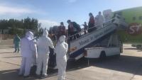 В Ош из Новосибирска прибыли граждане Кыргызстана